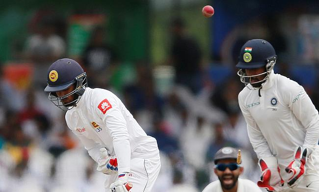 Dhananjaya de Silva (left) retired hurt after scoring a century