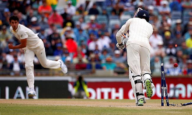 Australia's Mitchell Starc celebrates after bowling England's James Vince during the fourth day