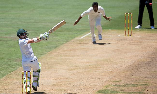 South Africa's Dean Elgar plays a shot off the bowling of India's Jasprit Bumrah.