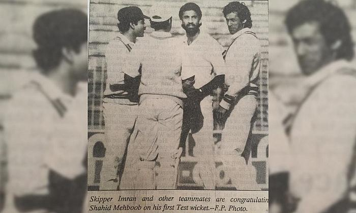 After claiming his first wicket - Imran Khan, on extreme right.
