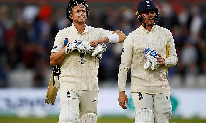 England's Jason Roy and Joe Denly leave the pitch at stumps