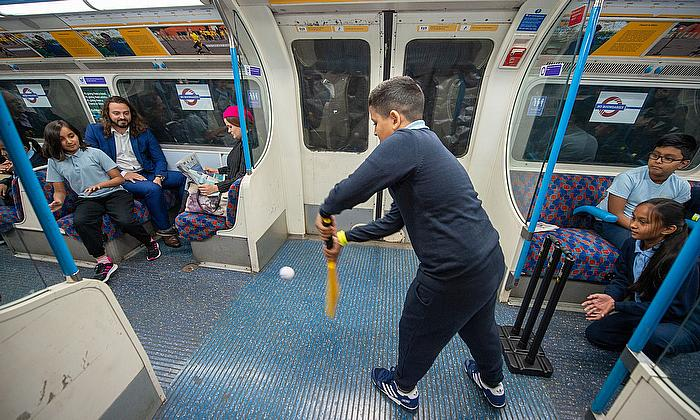 Sports-mad youngsters start a game of cricket on the tube