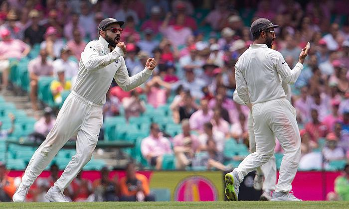 India's captain Virat Kohli celebrates with teammate Ajinkya Rahane