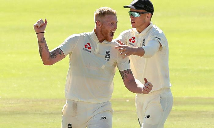 Ben Stokes and Sam Curran celebrate after winning the second test