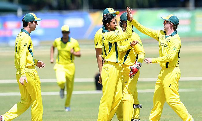 Tanveer Sangha of Australia celebrates the wicket of Sediqullah Atal of Afghanistan with his team mates during the ICC U19 Cricket World Cup