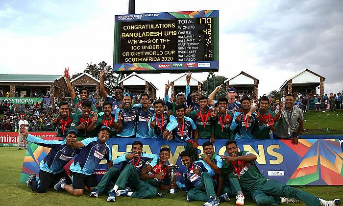 Bangladesh players celebrate with the trophy following victory during the ICC U19 Cricket World Cup Super League Final