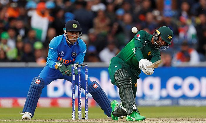 Pakistan's Fakhar Zaman hits a six to reach his half century