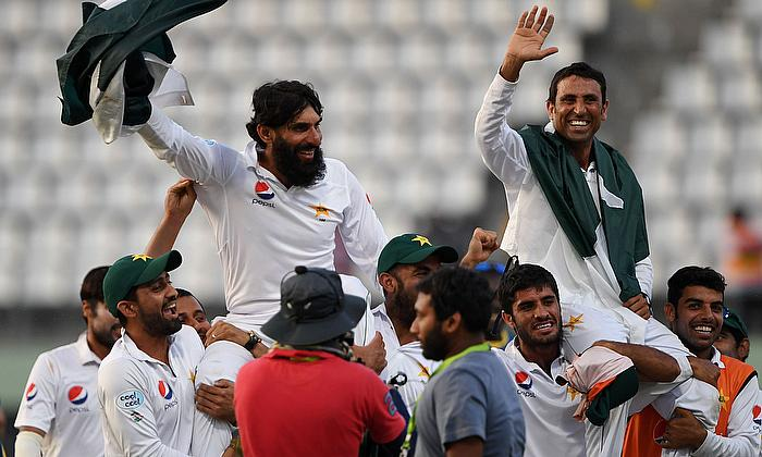 Younis Khan and Misbah ul Haq are carried by the teammates after celeberating the victory on their final test match