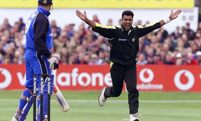 Pakistan's Waqar Younis celebrates taking the wicket of England's Owais Shah