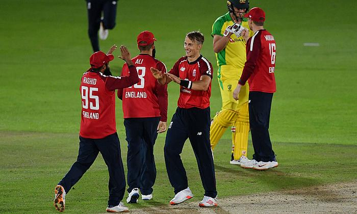 England's Tom Curran and Adil Rashid celebrate victory