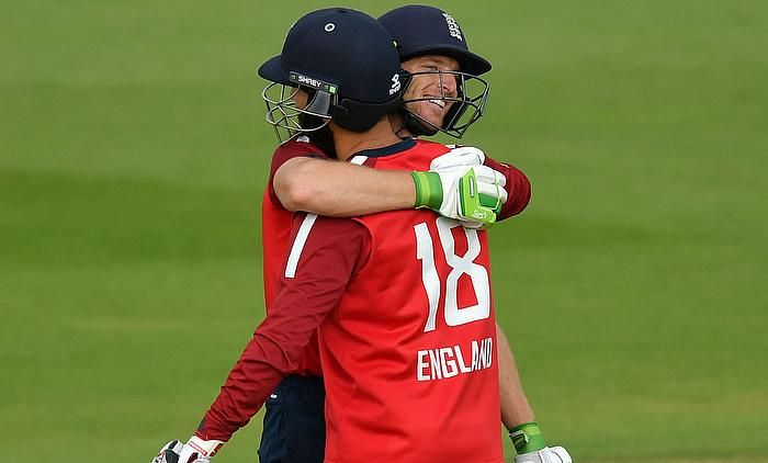 England's Jos Buttler and Moeen Ali celebrate after winning the match