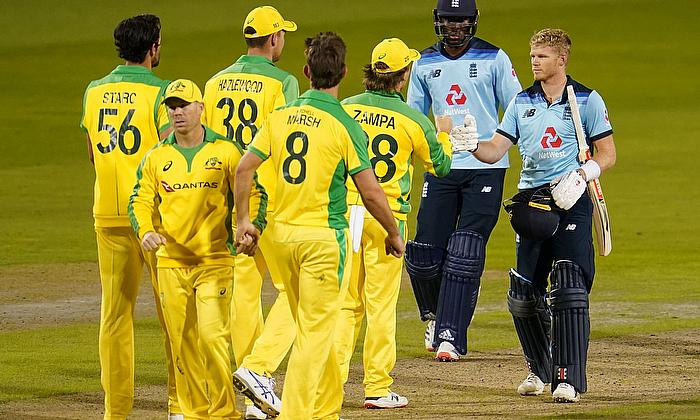 England's Sam Billings, Jofra Archer and Australia players after the match
