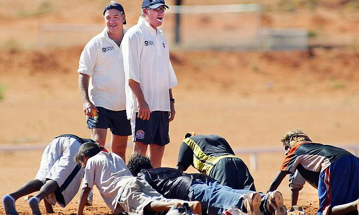 Australian cricketer Dean Jones takes local aboriginal children through fitness drills