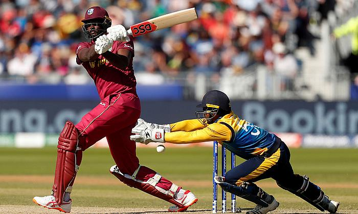 West Indies' Jason Holder hits a four against Sri Lanka