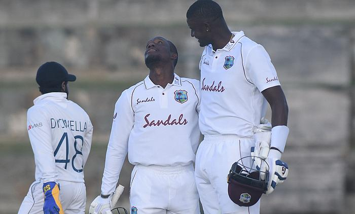 Nkrumah Bonner celebrates his century with Jason Holder