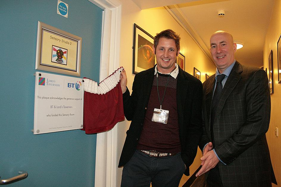 Durham's Phil Mustard and head teacher Chris Rollings unveil the BT Multi-Sensory room at Hadrian School