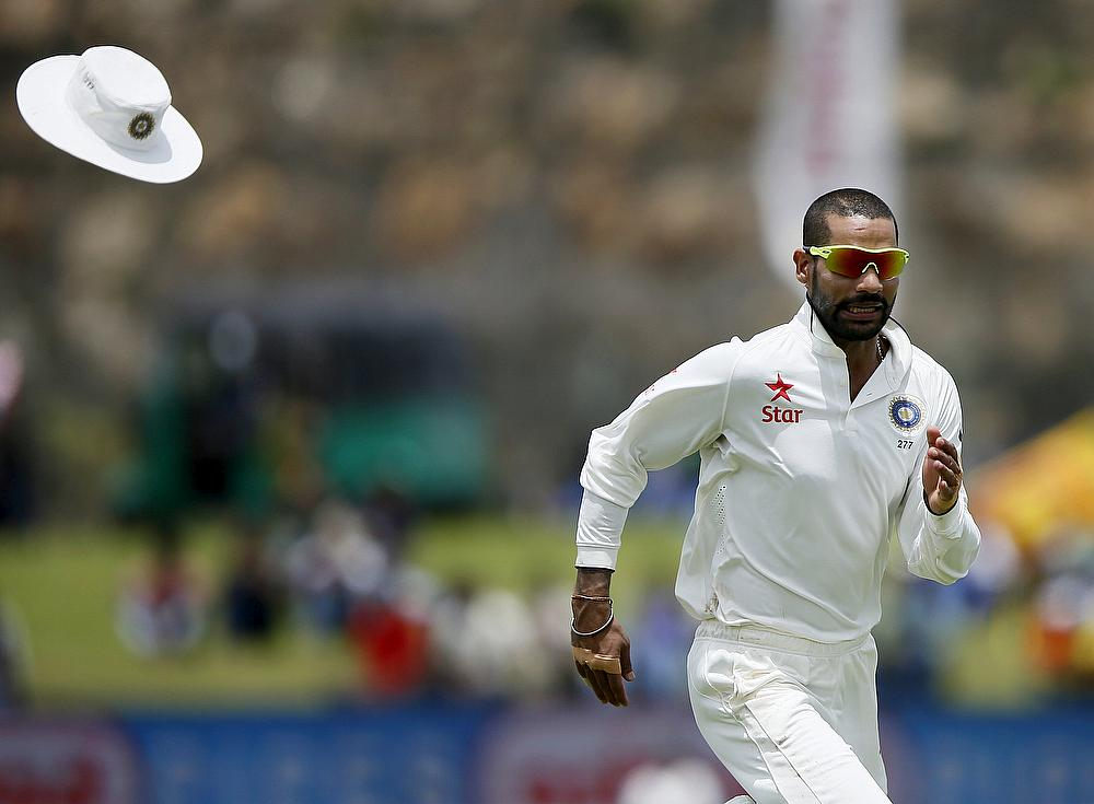 Shikhar Dhawan's bowling action reported