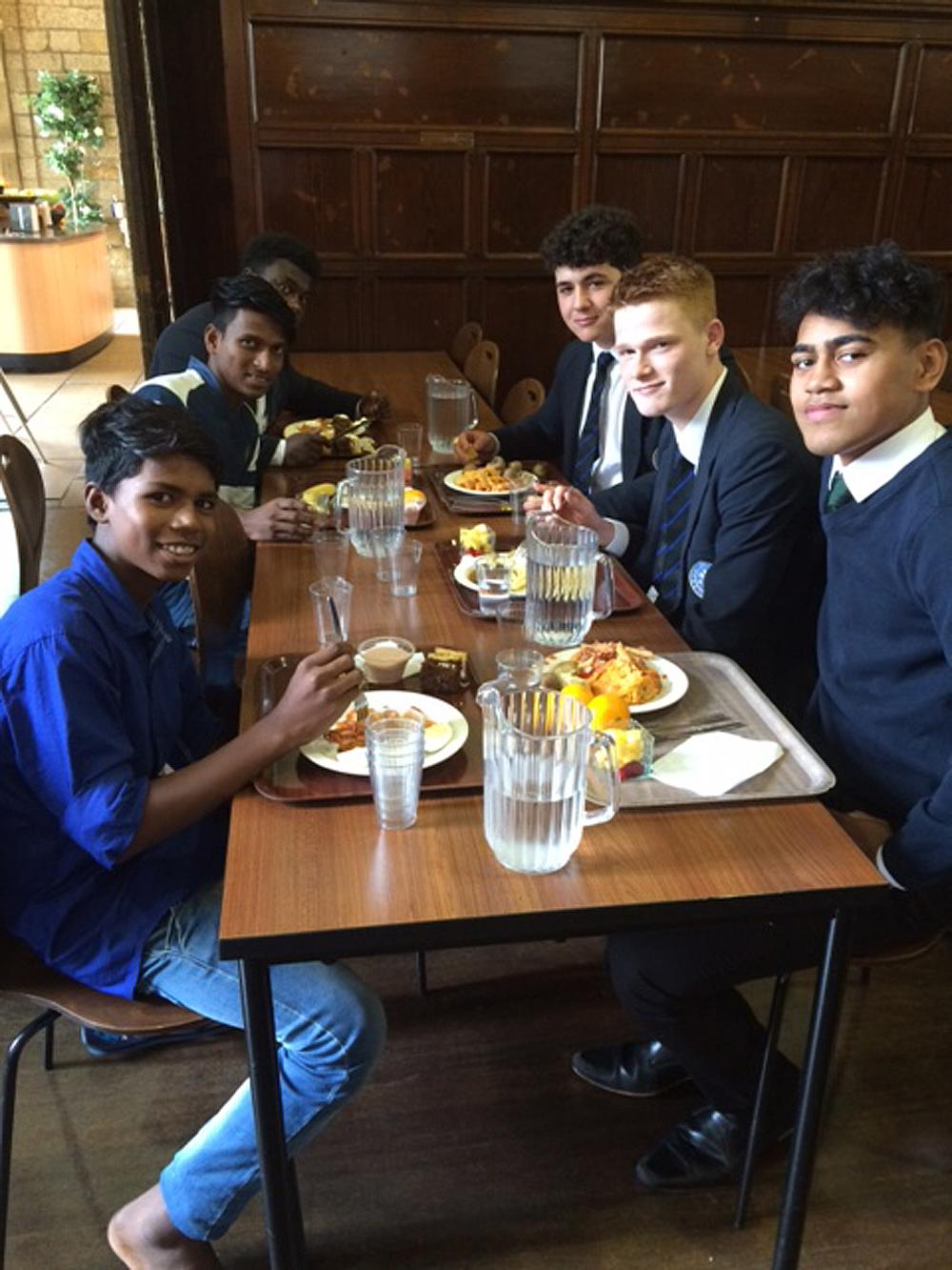 Rupesh and Prajwal eat with their new classmates