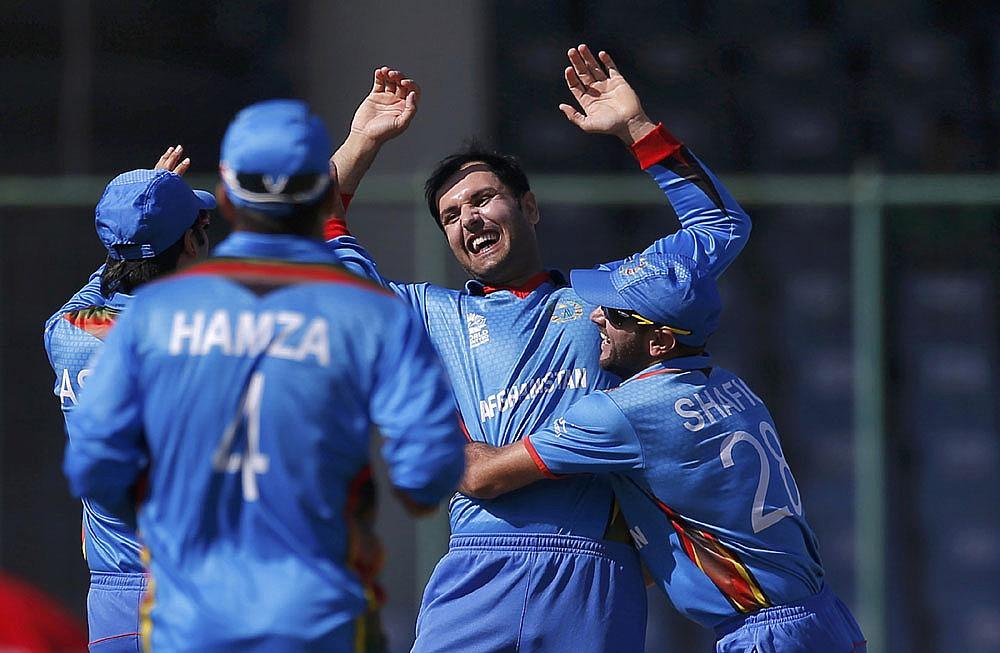 Afghanistan's Mohammad Nabi (2nd R) celebrates