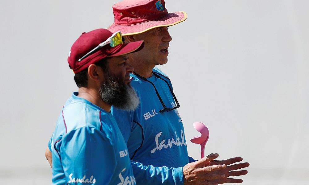 Richard Pybus talks with bowling coach Mushtaq Ahmed during nets