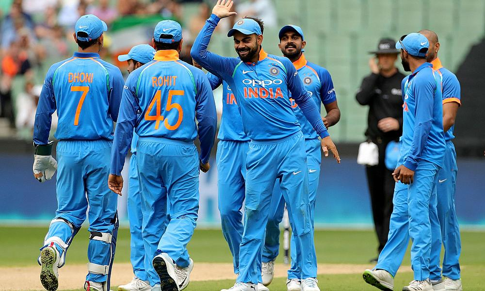 India's captain Kohli celebrates with his teammates