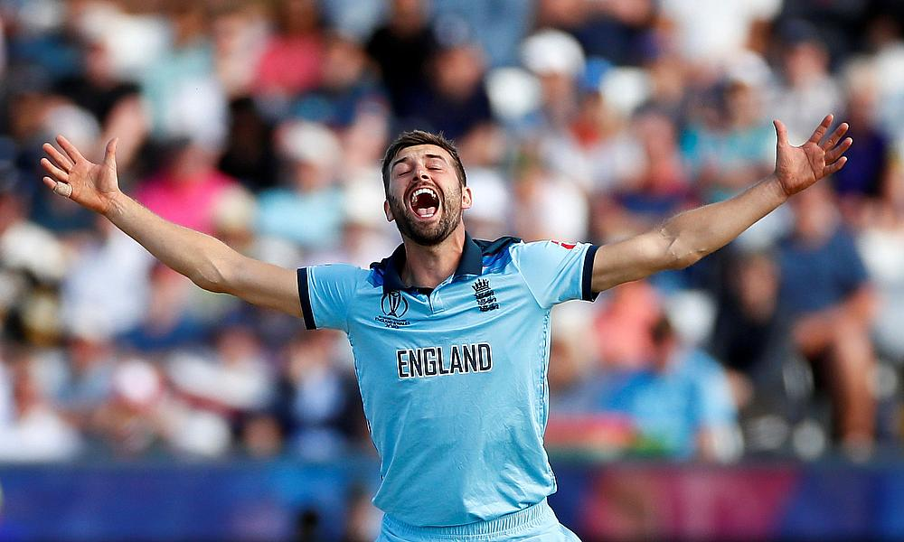 England's Mark Wood celebrates the dismissal of New Zealand's Mitchell Santner by LBW