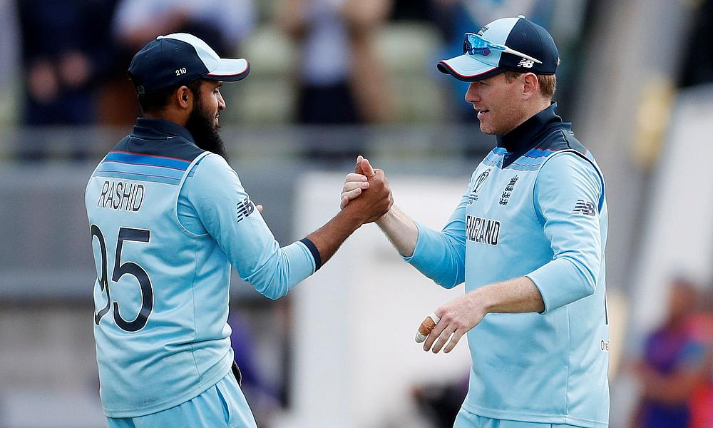 England's Adil Rashid shakes hands with Eoin Morgan at the end of the match