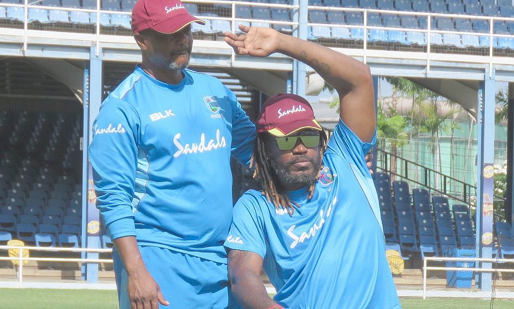 Chris Gayle with Zeph Nicholas during the warm-up session