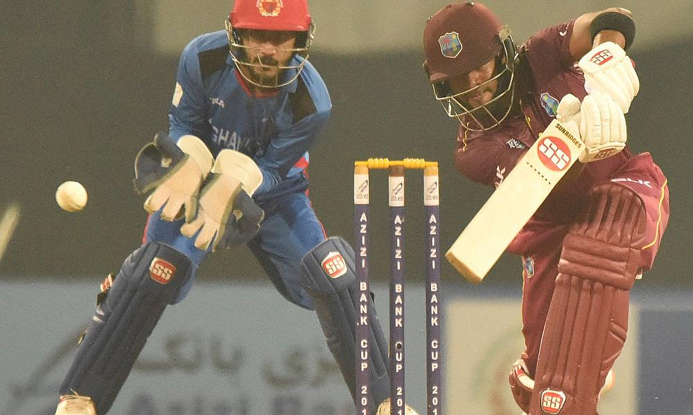 Shai Hope drives for four during his unbeaten century. He won the Man-of-the-Match award.