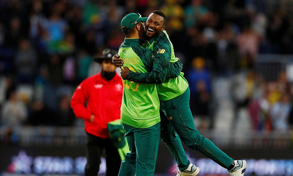 Andile Phehlukwayo celebrates taking the wicket of Australia's Nathan Lyon and winning the match