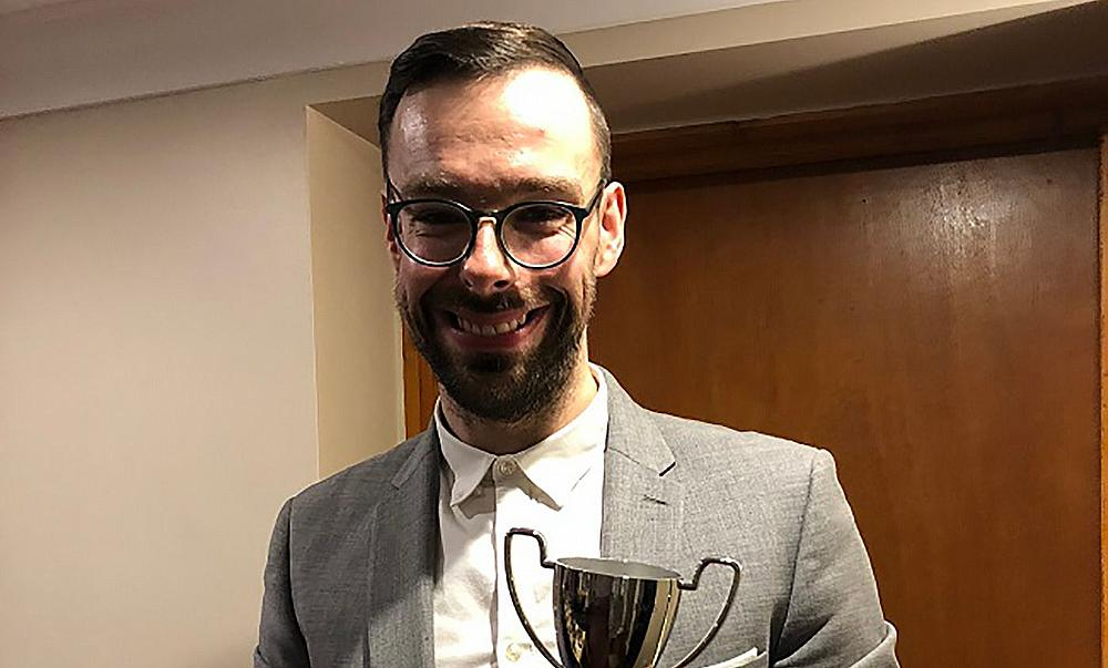 Andrew Edwards holding the trophy from Chirk Cricket Club's Presentation Evening in February 2019.