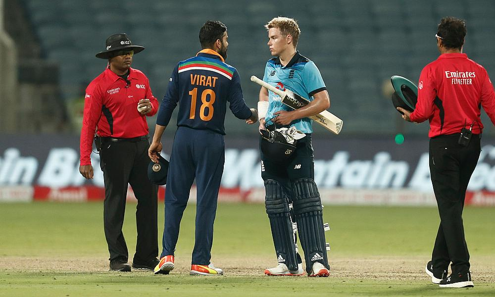 England's Sam Curran shakes hands with India's Virat Kohli after the match