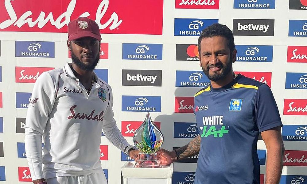 West Indies Captain Kraigg Brathwaite and  Sri lankan Captain Dimuth Karunaratne share the trophy